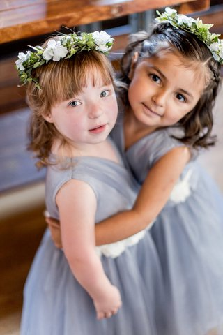 flower-girls-with-flower-crowns-blue-grey-dresses-white-sash-bangs-flower-crown
