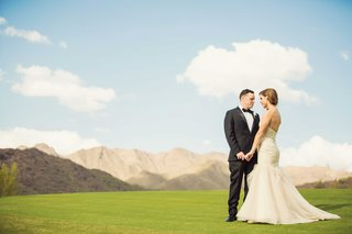 bride-in-strapless-mermaid-liancarlo-wedding-dress-with-groom-in-tuxedo-at-silverleaf-club-in-az