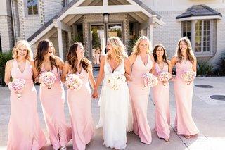 bride-in-christos-v-neck-wedding-dress-bridesmaids-in-pink-v-neck-dresses-from-dessy