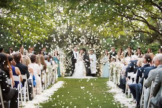 explosion-of-rose-petals-as-bride-and-groom-kiss