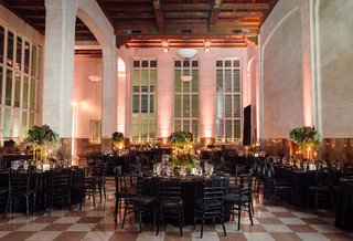 wedding-reception-high-ceilings-black-linens-round-and-rectangular-tables-high-medium-low-flowers