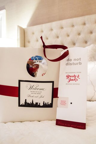 wedding-welcome-bag-chicago-skyline-red-ribbon-do-not-disturb-sign-recovering-from-wedding-weekend