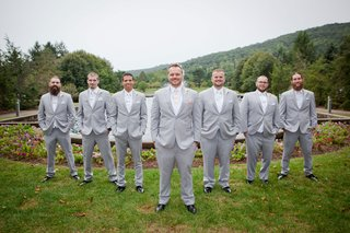 ashley-alexiss-wedding-groomsmen-in-light-grey-suits-white-ties-and-pink-tie-for-groom