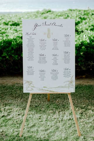 wedding-reception-signage-your-seat-awaits-pineapple-monogram-gold-drawing-of-shore-and-ocean-hawaii