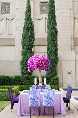 wedding-reception-at-the-ritz-carlton-dallas-garden-with-purple-linens-flowers-and-fuchsia-orchid