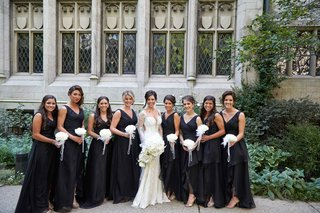bridesmaids-in-black-dresses-v-neck-holding-white-glamelia-bouquets-rose-petals-pearls-feathers