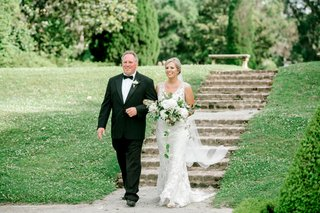 bride-in-v-neck-embroidery-wedding-dress-veil-blonde-loose-bouquet-father-in-tuxedo-stone-steps