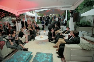 moroccan-style-wedding-lounge-with-guests-on-sofas-and-couches