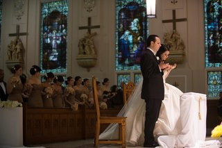 bride-and-groom-at-church-altar-for-white-wedding