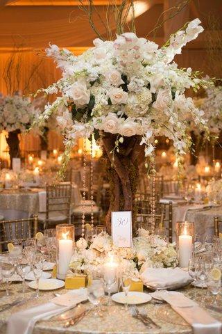 indoor-wedding-reception-with-tree-branch-centerpiece