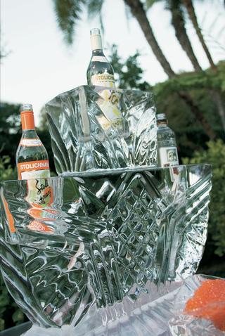 vodka-bottles-inside-ice-sculpture-at-wedding