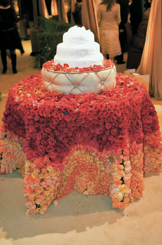 white-kosher-cake-on-table-covered-with-roses