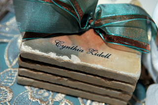 personalized-gold-coasters-wrapped-with-blue-ribbon