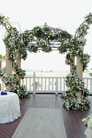 chuppah-made-of-vines-of-white-flowers-overlooking-ocean