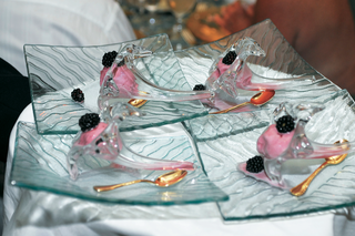 pink-ice-cream-and-blackberries-served-in-glass-flute