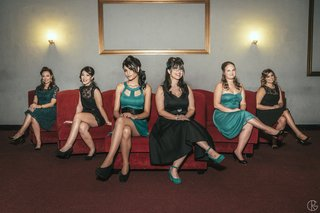 teal-and-black-bridesmaid-dresses-on-red-couches