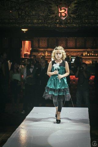 flower-girl-walking-down-runway-at-theater-wedding