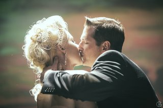 old-fashion-style-bride-and-groom-kissing