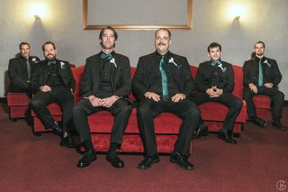 black-groomsmen-outfits-with-teal-ties-and-bow-ties