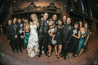 teal-and-black-bridesmaids-and-groomsmen-in-front-of-belasco-theater