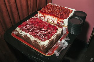 two-sheet-cakes-decorated-with-rose-petals-and-strawberries
