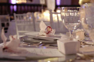 white-napkin-with-orchid-tucked-inside