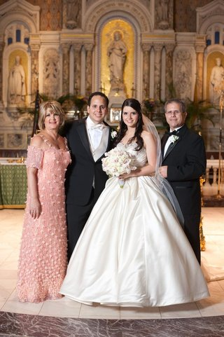 bride-and-groom-with-mother-and-father-in-church