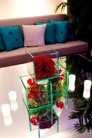 wedding-lounge-section-with-mirror-table-and-cube-vases