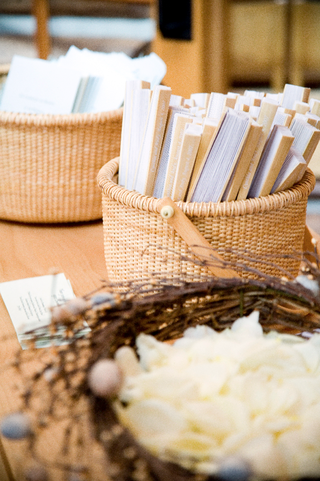 bird-nest-and-tan-baskets-on-wood-table