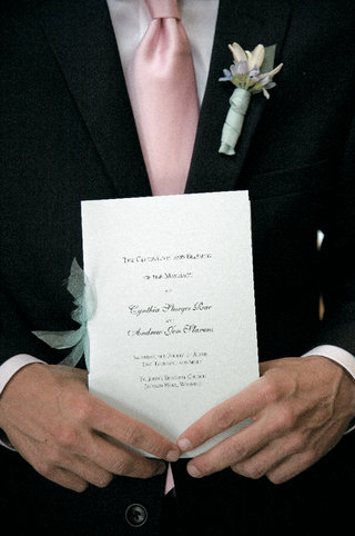 groomsman-holding-ceremony-booklet
