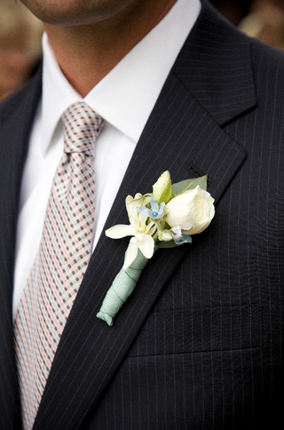 groom-in-pinstripe-suit-with-flowers-on-lapel