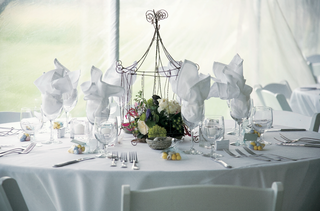 white-tablecloth-and-chairs-with-caged-flowers