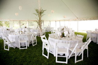 party-tent-filled-with-lanterns-and-round-tables