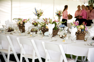 caterers-in-pink-and-long-table-with-bird-influences