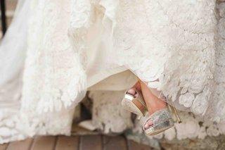 lace-wedding-dress-and-metallic-jimmy-choo-heels