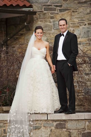 man-in-tuxedo-and-woman-in-a-line-bridal-gown