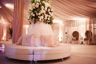 monogrammed-pink-pillows-and-tufted-furniture