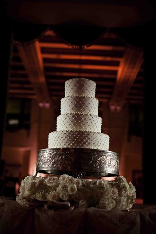 four-layer-round-cake-with-swiss-dots-on-silver-stand
