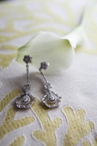 vintage-inspired-diamond-bridal-earrings-on-textile