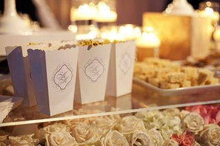 scallop-edged-popcorn-containers-on-bed-of-roses