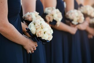 cream-and-pale-pink-roses-wrapped-in-navy-ribbon