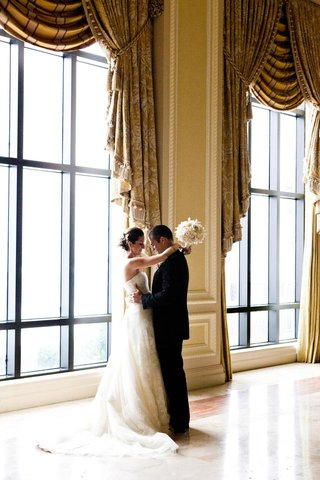 the-breakers-ballroom-bride-and-groom-embrace