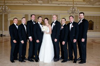 bride-and-groom-with-tux-groomsmen-at-the-breakers