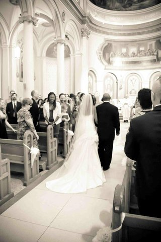 black-and-white-photo-of-bride-walking-down-aisle