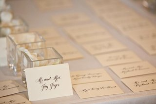 ivory-seating-card-with-black-calligraphy-lettering