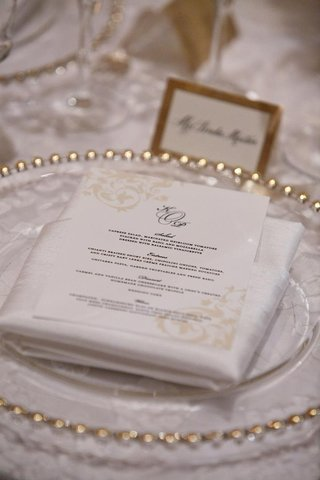 white-menu-card-on-gold-rimmed-charger-plate