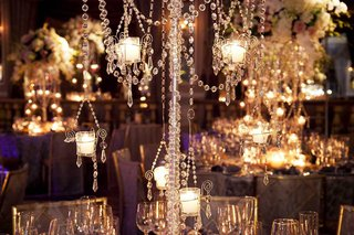 close-up-photo-of-crystal-strands-and-candles-on-centerpiece