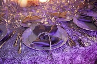 wedding-place-setting-with-rope-and-crystal-around-satin-napkin