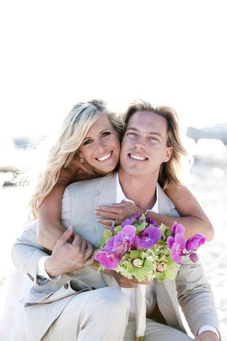 florida-beach-ceremony-bride-hugging-blond-groom