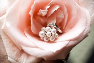 white-pearl-and-diamond-ring-on-pink-rose